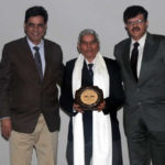 Amarjeet Malik and Vishal Bakshy felicitating K.C. Sharma Sir in Ashoka Auditorium, Manekshaw Centre, New Delhi